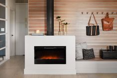 You typically might not think of an apartment as needing an entryway, but I felt like this was a good opportunity to set the tone for the rest of the home. Our cabinet maker, Marvin, installed this white oak wall treatment and it gave the space added texture while pairing beautifully with the new stucco fireplace.