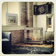 Here's an idea, cozy up to a Terra Flame Firespace and read a book. Fire Pits, Fireplaces, Collections, Outdoors, Cozy, Cool Stuff, Live, Modern, Products