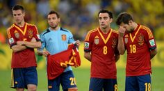 RIO DE JANEIRO, BRAZIL - JUNE 30: Xavi Hernandez of Spain and Jordi Alba (R) look dejected at the end of the FIFA Confederations Cup Brazil 2013 Final match between Brazil and Spain at Maracana on June 30, 2013 in Rio de Janeiro, Brazil. (Photo by Stuart Franklin - FIFA/FIFA via Getty Images)