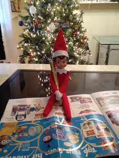 Elf on the shelf ideas -  Opie is taking notes for Jax to give to Santa!! #elfontheshelf