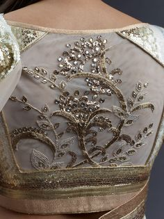gold work on the back of a sari blouse