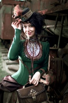 Steampunk Victorian dressed lady taking the equal of the stagecoach from past times. Her detailed dress is very colorful & eye catching.