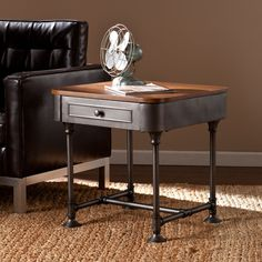 Blend this Upton Home end table into your décor to add a touch of reclaimed edginess. Dark tobacco wood and industrial gray, pipe style framework encompass the factory feel of modern industrial design. A light, open frame balances the broad drawer