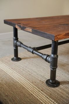 Turn some plumbing supplies and a couple of old planks into a great rustic industrial style coffee table.