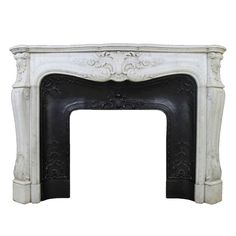 Antique Floral Louis XV Style Fireplace In White Carrara Marble from the 19th Century | From a unique collection of antique and modern fireplaces and mantels at https://www.1stdibs.com/furniture/building-garden/fireplaces-mantels/