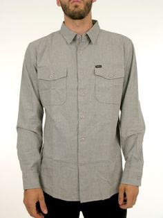 The Davis is a vintage inspired fitted woven long sleeve button shirt with adjustable button sleeves and two breast pockets. There is a Brix...
