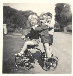 1952 3 boys on a trike, hitchin' a ride