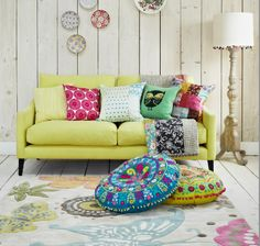 Sofa; floor cushions, Graham &  Green. Rug, Woven Ground. Cushions and fabric for cushions, from right: Fancy Moon, Donna Wilson at John Lewis, Camengo, Graduate Collection, Hus & Hen. Quilt, I Love Retro.