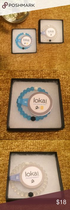 Clear and Blue Lokai Bracelets Classic M clear Lokai bracelet and S blue Lokai bracelet. Each has one white bead with material from Mount Everest and one black bead with material from the Dead Sea. Find your balance. NWT. Lokai Jewelry Bracelets