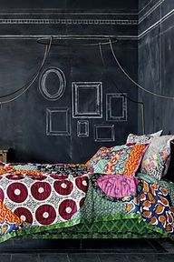 Dorm bedding & giant chalk board on wall. You can buy an entire sheet of masonite at the hardware store and coat it in chalkboard paint. This will look like you have a chalkboard wall instead of having to paint the wall itself!