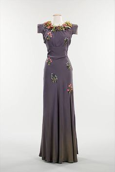 Evening dress  Elsa Schiaparelli (Italian, 1890–1973)  Date: fall 1938 Culture: French Medium: silk, plastic, metal    http://www.metmuseum.org/collections/search-the-collections/80093706?img=0
