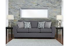 In the chicest shade of gray, Calion sofa's linen-weave upholstery complements so many color schemes and aesthetics. Flared arms, prominent welting and flamestitch-print pillows add just enough panache to this sweet and simple sofa. Supportive seat cushions and extra-wide arms make for one comfortable landing pad.