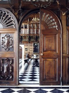 fantastically carved doors, lovely checkered flooring