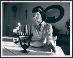 Ann Tsitlik, 12, lights the first candle on the menorah to mark the beginning of the eight days of Hanukkah in 1982. Her family had emigrated from the Soviet Union, where they were afraid to practice Judaism publicly; in the U.S., they joined the Baltimore Hebrew Congregation. Photo by Irving H. Phillips