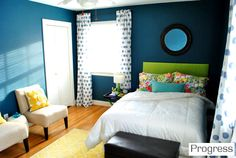 sea blue paint, DIY headboard, area rug, and floral pillows