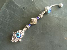 blue hamsa hand belly ring protection hamsa hand in belly dancer indie gypsy hippie morrocan boho and hipster style via Etsy