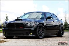 This supercharged Dodge Charger SRT8, prepared by Davenport Motorsports, is just as mean as it looks with supercharger, long tube headers, KW coilovers, Quaife torque-biasing differental, and Forgeline one piece forged monoblock GA1R wheels finished in Satin Black. See more at: http://www.forgeline.com/customer_gallery_view.php?cvk=844