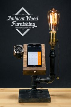 Here we incorporate our signature industrial lighting with phone & watch docking station. Serve as a perfect piece for your desktop display or bedside ambient luminance. Roughly sanded wood plate and solid metal pipe frame gives a strong industrial accent and high quality brass pull chain socket brings back great details.  Display phone model is iPhone 6, universal pre-drilled hole for charging cable. Apple Watch hole for charger. The hole made for it is for ONLY the original regular…
