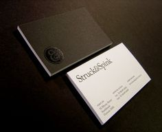Struck & Spink – Business cards printed in 1 offset colour 2 sides on Rives Design Bright White 350gsm.  Black gloss foiled logo.  Designed by Stuck & Spink.