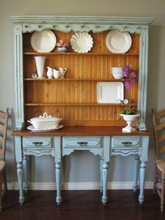 Spanish hutch painted in blue gray with natural beadboard wood back. by European Paint Finishes