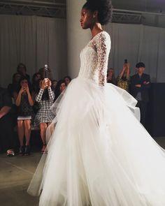 #MunaluchiBridalMagazine .... Beautiful hand beaded bodice and layered tulle skirt at @kennethpool. And we love seeing an Afro on the runway . #naturalhairbride #munafashion #bridalmarket #nybfw