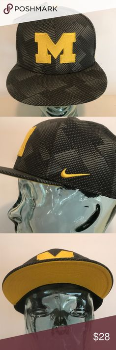 NIKE Michigan Wolverines Anthracite Snapback Hat NIKE Michigan Wolverines Anthracite True Adjust Snapback Hat  Material: 100% Polyester – Body; 80% Polyester/20% Cotton – Back of Front Panel; 100% Cotton – Underbill  STYLE: Snapback COLOR: Multi Grey, Yellow SIZE: One size fits most CONDITION: NEW! with tags Nike Accessories Hats