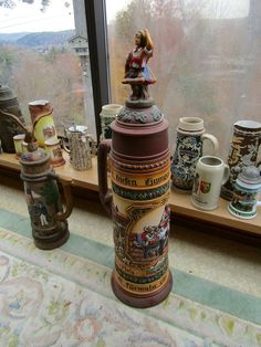 Large German and related porcelain, pottery and glass steins and pitchers.