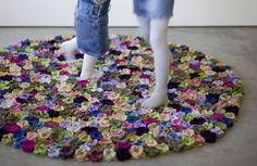"great flower carpet ""Nonna Pepa"" by Natalia Pepe. Hundereds of crochet flowers on a felt backing."