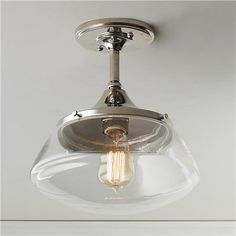 """Shades of Light - A modern adaptation on nostalgic diner style lighting, this ceiling light has clean lines and clear glass for timeless appeal. Available in Polished Nickel and Bronze. 1-75watt medium bulb max. Canopy 5"""" diameter x 1/2""""H. (11.5""""H x 10.5""""W)   Product SKU: FM14047 PN Price:  $96.00"""