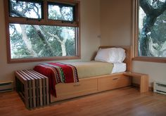love these windows, with the dark iron handles on wood... cool bed with storage and nightstand