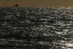SHIP SILHOUETTE: A towing vessel patrolled the sea near Boulogne-sur-Mer, France, as high winds battered northern France Monday. (Pascal Ros...