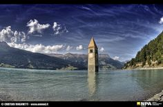 Reschenpass - Bell tower in the lake. Photo by Cristian Maganetti