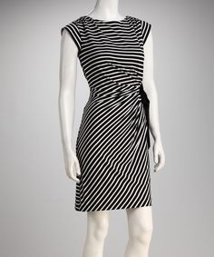 Any festive fashionista can appreciate a gorgeous go-to dress. With stylish stripes and a bow at the side, this frock will fit in at any affair.Measurements (size 6): 37'' long from high point of shoulder to hem91% polyester / 9% spandexMachine wash; tumble dryImported