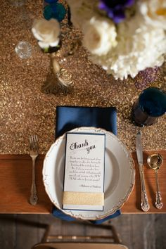 Gold glitter table runner with navy napkins and goblets   Blue Rose Photography