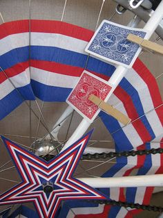 decking out bikes for the July 4th parade - complete with the playing cards!
