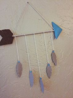 Arrow mobile- feather- nursery- tribal- unique home decoration by OhmannSquiresCrafts on Etsy https://www.etsy.com/listing/276135378/arrow-mobile-feather-nursery-tribal