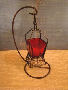 $27.00 Vintage Hanging Red Glass Lantern/Candle Holder. I bet this looks amazing with the lights off!