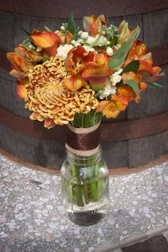 Pepper Plantation Charleston, SC fall wedding flowers - bridal bouquet with mums, parrot tulips, calla lilies, and off white stock