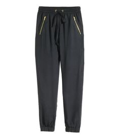Black. Joggers in an airy viscose weave with an elasticated drawstring waist…