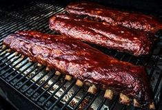 Pork spare ribs are soaked in apple juice overnight then seasoned with Traeger Big Game Rub and given a sweet glaze. BBQ them on the Traeger for sweet & smoky ribs you'll love. Traeger Bbq, Traeger Grills, Traeger Recipes, Smoked Pork Ribs, Bbq Pork Ribs, Ribs On Grill, Smoked Trout, Pork Loin, Ribs