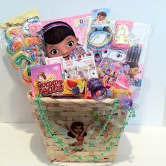 Kids Gift Basket Pretty Basket for a Pretty Girl~Vera Mae Collection (Ages 4 to 8)  Doc Big Fun Book To Color (8) Disney Crayon (6) Mini Carnival Pops Gummy Band Candy Light -up Ring (1) Ice Cream Lip-Gloss Play Flake Money  Candyland 2 Piece Lip Gloss and 5 Body Tattoos  Necklace on the Basket is Removable Chocolate Chip Cookies Puzzle Coloring Set and 4 Crayon Tiara Candy Bracelet and Watch (4) Disney Bracelets Hair Brush  Hair Accessories 'Sold'