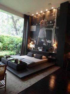 This is a cool look for a bedroom, but I'm just liking the idea of the huge photo wall. I'd like to do something like this in my office...with a different photo.
