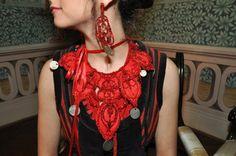 Authentic HUngarian coin folk jewellry redesign necklace, earrings. Antique coins and red grinded glass beads are sewed on a wool./ Rábaközi lázsiás, nyakék, fülbevaló redesign. Csiszolt piros színű üveg antik pénzérmék vannak gyapjú anyagra varrva.