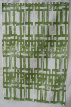 Tea towel green carved grid by Manymakepeaces on Etsy, $30.00 AU plus postage