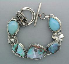 Temi Kucinski - Handmade Sterling Silver Blue Opal Bracelet. Via Etsy.