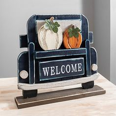 "Give your guests a warm fall farmhouse greeting with our beautiful Blue Welcome Truck Porch Sign. You'll love the rustic look of this festive porch sign.             Sign measures 23.5L x 4.75W x 21.5H in.          Crafted of wood          Features pick up truck design with pumpkin accents          Features the phrase ""WELCOME"" in white lettering          Hues of blue, gray, white, orange, and green          Safe for covered outdoor use.          Care: Dust with a soft, dry cloth…"