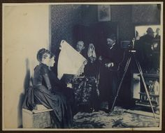 Photograph of women being photographed, ca. 1890.