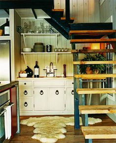 What an adorable tiny kitchen strategically places under the stairs! And THOSE STAIRS!
