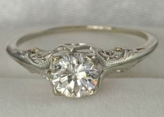 gorgeous vintage ring, would want a cushion cut diamond instead of round