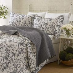 Offering a beautiful refresh for your master suite, this reversible cotton quilt set showcases a delicate floral motif.   Product: ...
